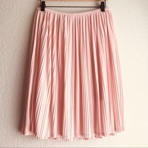 Pink pleated knee length skirt size S